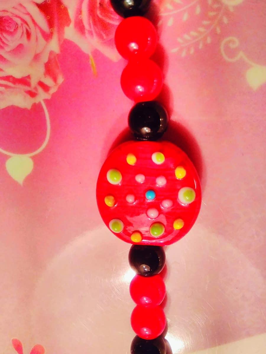 Handmade Red and black glass beads. 4
