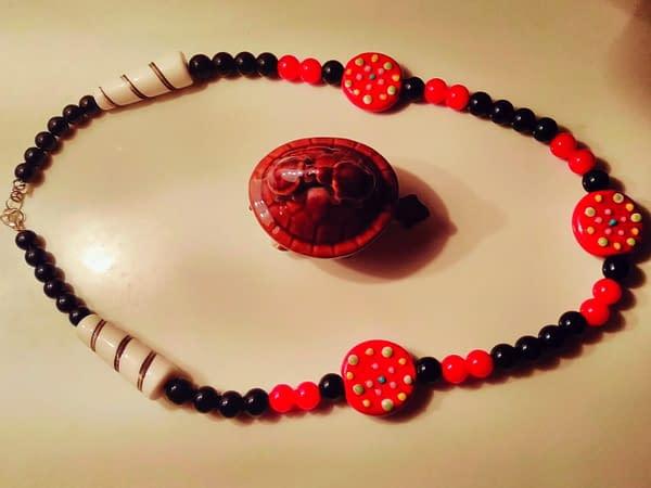 Handmade Red and black glass beads.
